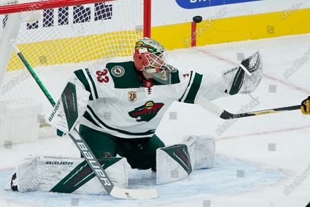 Minnesota Wild goaltender Cam Talbot (33) looks at an attempted shot by the Vegas Golden Knights during the first period of an NHL hockey game, in Las Vegas