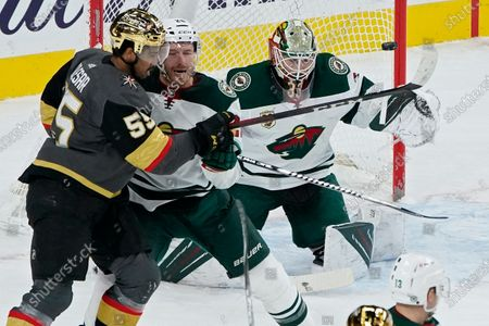 Shot by the Vegas Golden Knights hits a goal post beside Minnesota Wild goaltender Cam Talbot (33) as defenseman Ian Cole (28) guards Vegas Golden Knights right wing Keegan Kolesar (55) during the first period of an NHL hockey game, in Las Vegas