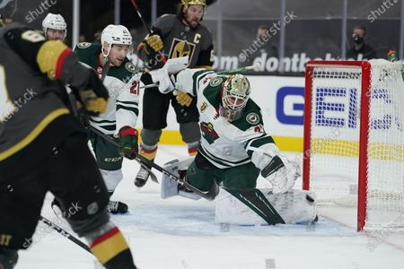 Vegas Golden Knights left wing Max Pacioretty, left, scores on Minnesota Wild goaltender Cam Talbot (33) during the second period of an NHL hockey game, in Las Vegas
