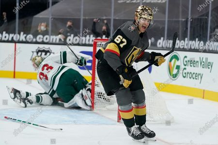 Vegas Golden Knights left wing Max Pacioretty (67) celebrates after scoring against Minnesota Wild goaltender Cam Talbot (33) during overtime of an NHL hockey game, in Las Vegas