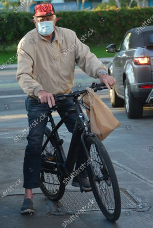 Exclusive - George Lazenby on a bike ride in Santa Monica