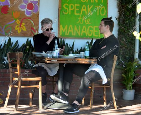 Calvin Klein and Kevin Baker having lunch in West Hollywood