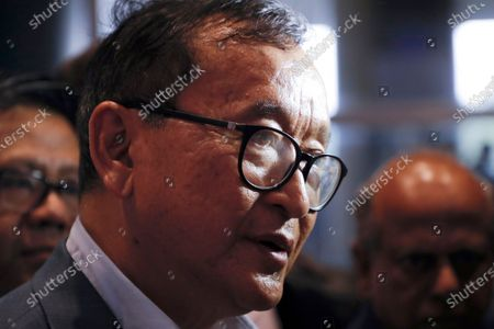 Cambodia's exiled opposition leader Sam Rainsy talks with the media upon arrival at Kuala Lumpur International Airport in Sepang, Malaysia, in a bid to return to his homeland after Thailand had earlier blocked him from entering. Phnom Penh Municipal Court has convicted and sentenced the exiled leader and senior members of the country's banned opposition party to more than 20 years in prison, effectively barring them from ever returning home. The decision taken by the court late was condemned by the head of the Cambodia National Rescue Party, or CNRP, human rights organizations and the United States embassy. The trial was held in absentia as all the party leaders are living abroad