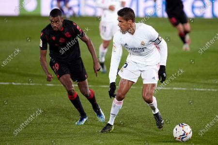 Raphael Varane of Real Madrid in action with Alexander Isak of Real Sociedad during the Spanish Liga Santander match between Real Madrid and Real Sociedad at Estadio Alfredo Di Stefano in Madrid, Spain.