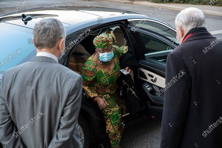"""Stock Picture of Ngozi Okonjo-Iweala (C) arrives at the World Trade Organization headquarters in Geneva, Switzerland, on March 1, 2021. The World Trade Organization's first female and first African Director General, Ngozi Okonjo-Iweala, officially took office on Monday, ending a six-month """"leaderless"""" period of the organization, after former chief Roberto Azevedo stepped down on Aug. 31, 2020, a year ahead of schedule."""
