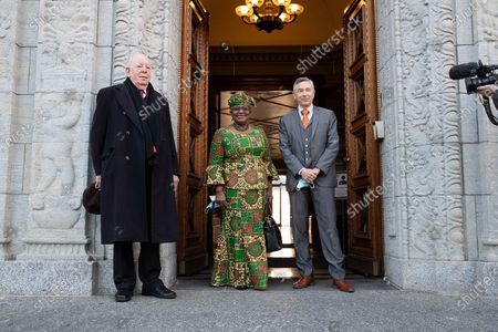 """Stock Image of Ngozi Okonjo-Iweala (C) arrives at the World Trade Organization headquarters in Geneva, Switzerland, on March 1, 2021. The World Trade Organization's first female and first African Director General, Ngozi Okonjo-Iweala, officially took office on Monday, ending a six-month """"leaderless"""" period of the organization, after former chief Roberto Azevedo stepped down on Aug. 31, 2020, a year ahead of schedule."""