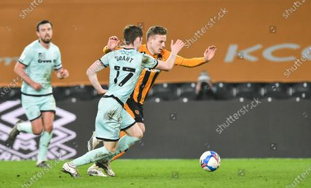 James Scott of Hull City and Conor Grant of Rochdale