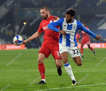 Birmingham City's Harlee Dean battles with Huddersfield's Fraizer Campbell