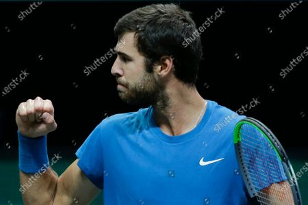 Stock Image of Russia's Karen Khachanov celebrates winning in two sets, 6-4, 7-5, against Switzerland's Stan Wawrinka in their first round men's singles match of the ABN AMRO world tennis tournament at Ahoy Arena in Rotterdam, Netherlands