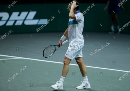 Switzerland's Stan Wawrinka walks to his seat after losing in two sets, 6-4, 7-5, against Russia's Karen Khachanov in their first round men's singles match of the ABN AMRO world tennis tournament at Ahoy Arena in Rotterdam, Netherlands