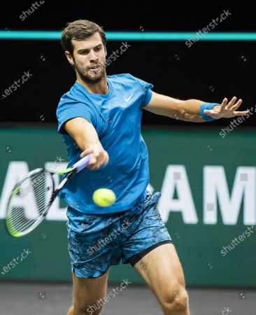 Stock Photo of Karen Khachanov of Russia in action against Stan Wawrinka of Switzerland on the second day of the ABN AMRO World Tennis Tournament in Rotterdam, The Netherlands, 02 March 2021. The ATP tournament in Ahoy takes place without an audience due to the corona pandemic.