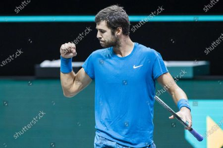 Stock Picture of Karen Khachanov of Russia reacts after winning against Stan Wawrinka of Switzerland on the second day of the ABN AMRO World Tennis Tournament in Rotterdam, The Netherlands, 02 March 2021. The ATP tournament in Ahoy takes place without an audience due to the corona pandemic.