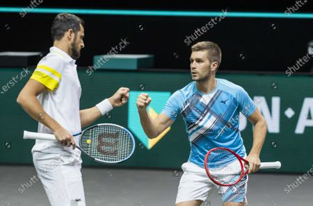 Mate Pavic (L) and Nikola Mektic of Croatia in action against Robin Haase and Matwe Middelkoop on the second day of the ABN AMRO World Tennis Tournament in Rotterdam, The Netherlands, 02 March 2021. The ATP tournament in Ahoy takes place without an audience due to the corona pandemic.