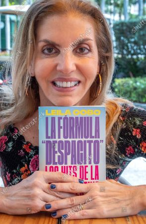 Leila Cobo, Billboard's Latin Music vice-president, holds her new book 'La Formula Despacito' during an interview with EFE in Key Biscayne, Florida, USA, 01 March 2021 (issued 02 March). 'La Formula Despacito' (Decoding Despacito) is being released on 02 March and tracks the stories behind the biggest Latin hits of the past fifty years.