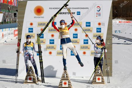 Winner Therese Johaug of Norway, center, celebrates flanked by second placed Frida Karlsson of Sweden, left, and third placed Ebba Andersson of Sweden after the 10km women's interval start free race at the FIS Nordic World Ski Championships in Oberstdorf, Germany