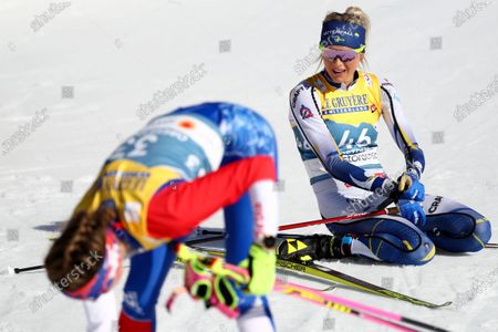 Second placed Frida Karlsson of Sweden sits on the ground after the 10km women's interval start free race at the FIS Nordic World Ski Championships in Oberstdorf, Germany