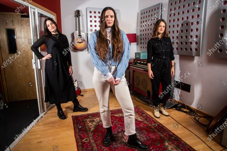 """Members of the folk group The Staves, sisters, from left, Jessica, Camilla and Emily Staveley-Taylor pose in a north London recording studio to promote their album """"Good Woman"""", on"""