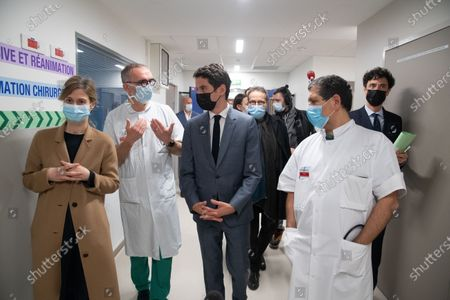 Stock Image of Mr. Gabriel Attal, Secretary of State to the Prime Minister, spokesperson for the Government, went to the Saint-Louis hospital and visited the hospital's resuscitation service then to discuss with the hospital staff.