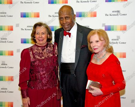 Ann Jordan, left, Vernon Jordan, center, and Buffy Cafritz, right, arrive for the formal Artist's Dinner honoring the recipients of the 39th Annual Kennedy Center Honors hosted by United States Secretary of State John F. Kerry at the U.S. Department of State in Washington, D.C.. The 2016 honorees are: Argentine pianist Martha Argerich; rock band the Eagles; screen and stage actor Al Pacino; gospel and blues singer Mavis Staples; and musician James Taylor.