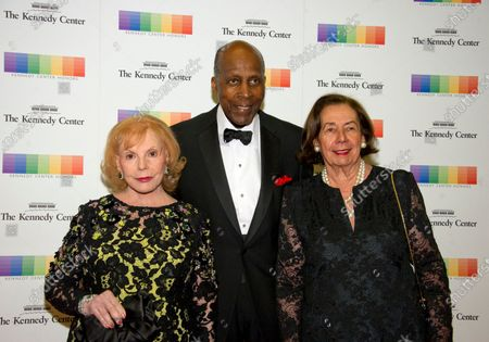 Stock Picture of Buffy Cafritz, left, Vernon Jordan, center, and Ann Jordan arrive for the formal Artist's Dinner honoring the recipients of the 40th Annual Kennedy Center Honors hosted by United States Secretary of State Rex Tillerson at the US Department of State in Washington, D.C.. The 2017 honorees are: American dancer and choreographer Carmen de Lavallade; Cuban American singer-songwriter and actress Gloria Estefan; American hip hop artist and entertainment icon LL COOL J; American television writer and producer Norman Lear; and American musician and record producer Lionel Richie.