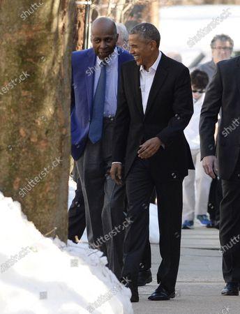 United States President Barack Obama walks with civil rights icon Vernon Jordan (L), in Washington, DC. President Obama attended an Alfalfa luncheon in Vernon Jordan's house.