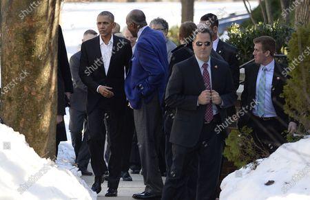 United States President Barack Obama walks with civil rights icon Vernon Jordan (R), in Washington, DC. President Obama attended an Alfalfa luncheon in Vernon Jordan's house.