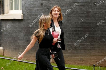 Stock Picture of Government Press Secretary Allegra Stratton (R) walks along Downing Street in London, England, on March 2, 2021.