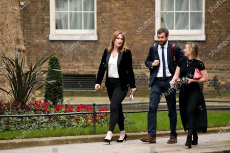 Stock Image of Government Press Secretary Allegra Stratton (L) walks along Downing Street in London, England, on March 2, 2021.