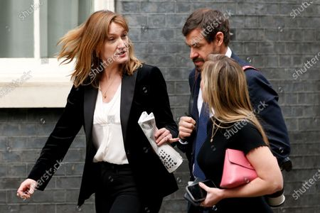 Government Press Secretary Allegra Stratton (L) walks along Downing Street in London, England, on March 2, 2021.
