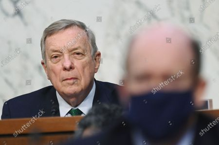 Sen. Dick Durbin, D-Ill., listens as FBI Director Christopher Wray testifies before the Senate Judiciary Committee on Capitol Hill in Washington