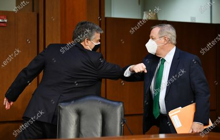 FBI Director Christopher Wray (L) and Chairman Senator Dick Durbin, D-IL, tap elbows after Wray testified before the Senate Judiciary Committee on the January 6th insurrection, in the Hart Senate Office Building on Capitol Hill in Washington, DC, USA, on 02 March 2021.