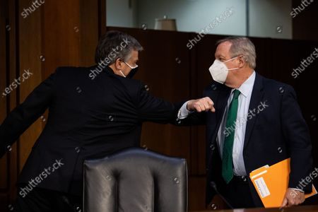 Federal Bureau of Investigation Director Christopher Wray bumps elbows with United States Senator Dick Durbin (Democrat of Illinois), Chairman, US Senate Committee on the Judiciary after testifying on Capitol Hill, in Washington, before a Senate Judiciary Committee on the the January 6th Insurrection, domestic terrorism and other threats,Tuesday,.