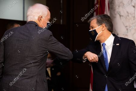 Federal Bureau of Investigation Director Christopher Wray meets with United States Senator John Cornyn (Republican of Texas), on Capitol Hill, in Washington, before a Senate Judiciary Committee on the the January 6th Insurrection, domestic terrorism and other threats,Tuesday,.