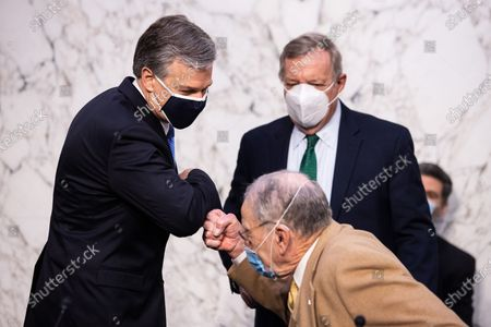 Federal Bureau of Investigation Director Christopher Wray meets with Senator Chuck Grassley, R-IA, and Senate Judiciary Committee Senator Dick Durbin, D-IL, before a Senate Judiciary Committee looking into the January 6th Insurrection, domestic terrorism and other threats,on Capitol Hill