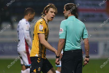 Joe Ironside of Cambridge United (20) yells at Referee Craig Hicks