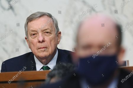 Senate Judiciary Committee Chairman Senator Dick Durbin, D-IL, listens as Federal Bureau of Investigation Director Christopher Wray testifies before a Senate Judiciary Committee looking into the January 6th Insurrection, domestic terrorism and other threats, on Capitol Hill