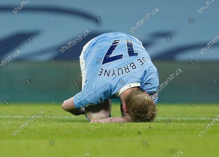 Stock Photo of Kevin De Bruyne of Manchester City feels the pain from a knock