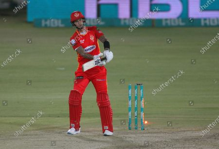 Stock Photo of Islamabad United' Alex Hales reacts while he bowled out by Quetta Gladiators' ahid Mahmood during a Pakistan Super League T20 cricket match between Islamabad United and Quetta Gladiators at the National Stadium, in Karachi, Pakistan