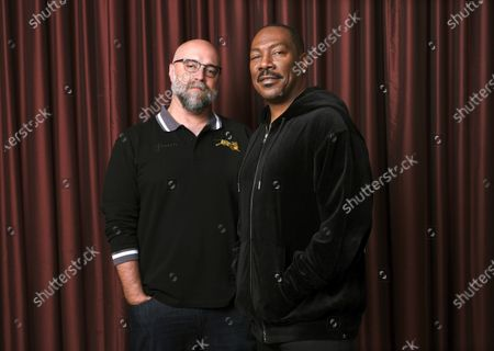 """Actor Eddie Murphy, right, poses with director Craig Brewer during the Toronto International Film Festival in Toronto on . Murphy stars in """"Coming 2 America,"""" available on Amazon Prime on March 5"""
