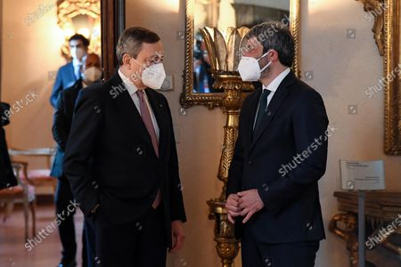 Italian Prime Minister Mario Draghi (L) speaks with Roberto Fico (R), President of Chamber of Deputies, at Palazzo Borromeo for the 92th anniversary of Lateran Treaty, in Rome, Italy, 02 March 2021.