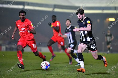 Joe Adams (45) Grimsby Town on the ball as Tunji Akinola (18) of Leyton Orient goes to challenge during the EFL Sky Bet League 2 match between Grimsby Town FC and Leyton Orient at Blundell Park, Grimsby