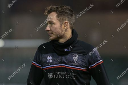 Tom Hopper (9) of Lincoln City  in the warm up session  during the EFL Sky Bet League 1 match between Lincoln City and Fleetwood Town at Sincil Bank, Lincoln