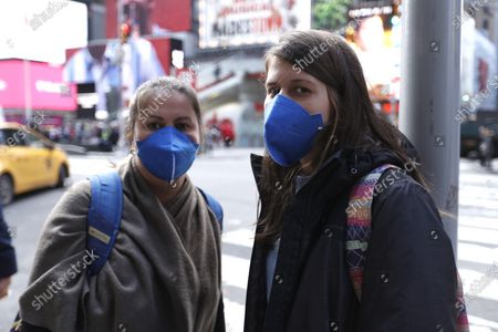 Stock Picture of Women wearing a protective mask walk around the Broadway Theatre that Broadway productions have been suspended on March 12, 2020 in New York City. Amid the COVID19 (coronavirus) concerns and a ban on groups of 500 of people, a directive issued by New York State Andrew Cuomo, all of Broadway performances have been closed until April 12, 2020. President Charlotte St. Martin of the Broadway League issued statement stating that Broadway is committed to enrich and foster enrichment and to inspire all the while entertain its visitors. Additionally, the league is committed to protect all those who work in the industry.