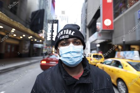 A an wearing a protective mask walk around the Broadway Theatre that Broadway productions have been suspended on March 12, 2020 in New York City. Amid the COVID19 (coronavirus) concerns and a ban on groups of 500 of people, a directive issued by New York State Andrew Cuomo, all of Broadway performances have been closed until April 12, 2020. President Charlotte St. Martin of the Broadway League issued statement stating that Broadway is committed to enrich and foster enrichment and to inspire all the while entertain its visitors. Additionally, the league is committed to protect all those who work in the industry.
