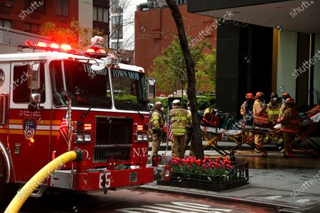 Emergency Services Rescue Personnel and Firemen  in New York, on April 23, 2020. New York Fire Department and Emergency services technicians were dispatched to a high-rise in New York City on April 23, 2020. Scores of firetrucks, ambulances and EMT rescue medics stood ready in front of Murray Hill towers on 2nd Avenue.