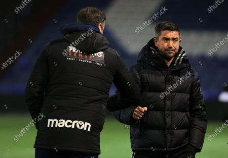 Bolton Wanderers manager Ian Evatt and Oldham Athletic manager Harry Kewell bump elbows after the EFL Sky Bet League 2 match between Oldham Athletic and Bolton Wanderers at Boundary Park, Oldham