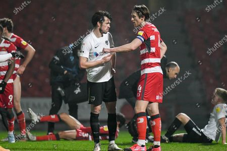 Portsmouth forward John Marquis (9) and Doncaster Rovers defender Tom Anderson (4) chat after the match during the EFL Sky Bet League 1 match between Doncaster Rovers and Portsmouth at the Keepmoat Stadium, Doncaster