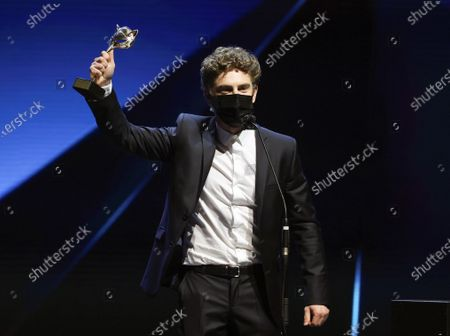 Stock Image of Patrick Criado reacts after receiving the 'Best Supporting Actor in a TV Series' award during the 8th Feroz Awards gala at the Coliseum Theater in Madrid, Spain, 02 March 2021. The award handout ceremony acknowledges prominent works in Spanish cinema and television productions.