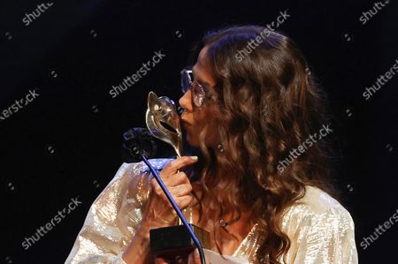 Victoria Abril reacts after receiving the 'Feroz Honorary Award 2021' during  the 8th Feroz Awards gala at the Coliseum Theater in Madrid, Spain, 02 March 2021. The award handout ceremony acknowledges prominent works in Spanish cinema and television productions.