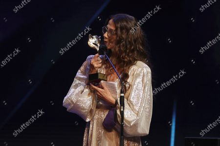 Stock Image of Victoria Abril reacts after receiving the 'Feroz Honorary Award 2021' during  the 8th Feroz Awards gala at the Coliseum Theater in Madrid, Spain, 02 March 2021. The award handout ceremony acknowledges prominent works in Spanish cinema and television productions.
